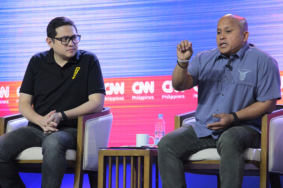 Ronald 'Bato' dela Rosa clarifies his stance on the death penalty as Bam Aquino listens. (Photo by Jun Madrid, UP MPRO)
